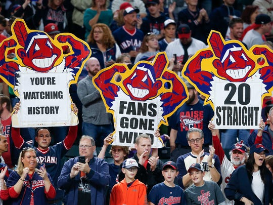 Indians fans celebrate after the Tigers' 2-0 loss to the Indians on Tuesday, Sept. 12, 2017, in Cleveland. The Indians won their 20th game in a row, tying the American League record. (AP Photo/Ron Schwane)