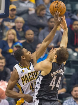 Bojan Bogdanovic (44) shoots the ball while Indiana Pacers guard Glenn Robinson III (40) defends in the first quarter of the game at Bankers Life Fieldhouse.