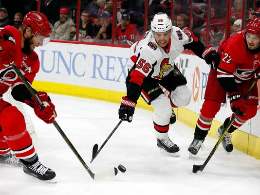 Carolina Hurricanes' Jordan Staal (11) and Brett Pesce (22) take the puck away from Ottawa Senators' Magnus Paajarvi (56) during the first period of an NHL hockey game, Tuesday, Jan. 30, 2018, in Raleigh, N.C. (AP Photo/Karl B DeBlaker)