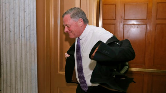 Sen. Richard Burr, R-N.C., puts his jacket on as he heads to the Senate floor on Capitol Hill Tuesday in Washington.