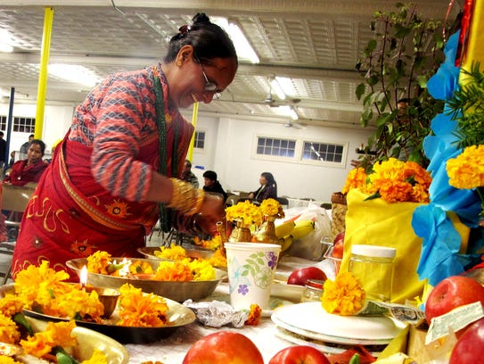 Naramaya Adakari tends to a shrine to the Hindu goddess