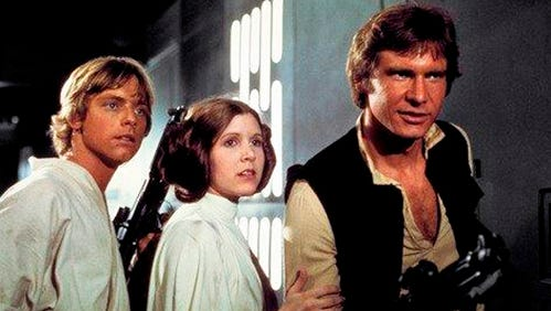 """This photo provided by Twentieth Century Fox Home Entertainment shows, Mark Hamill, from left, as Luke Skywalker, Carrie Fisher as Princess Leia Organa, and Harrison Ford as Hans Solo in the original 1977 """"Star Wars: Episode IV - A New Hope"""" film."""