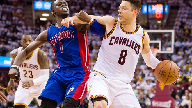 Pistons guard Reggie Jackson fouls Cavaliers guard Matthew Dellavedova during the second half of Game 2 Wednesday in Cleveland.