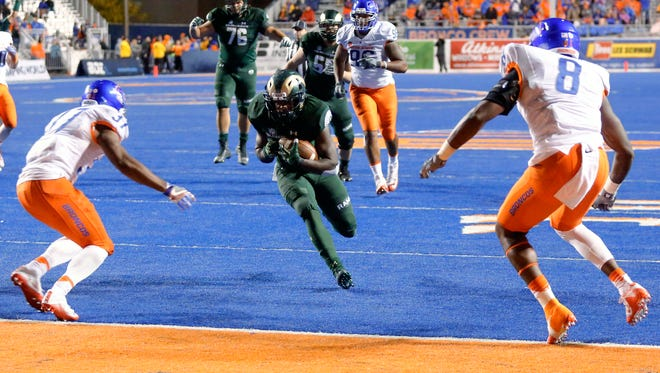 Dalyn Dawkins, CSU's leading rusher, runs for a touchdown in an Oct. 15 game at Boise State. Colorado State used a strong ground game to win its final four games a year ago, and Dawkins and his teammates believe they can do the same again this season.