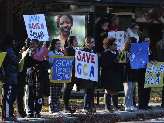 Students from Good Counsel Academy rallied outside the school on North Broadway in White Plains in November to keep the school open.
