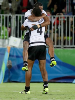 Fiji celebrates a win against Great Britain for gold.