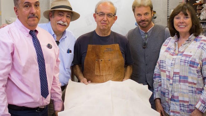 From left, Andrew Sesta, president of Stuart Rotary Club, Stuart Mayor Tom Campenni, Eduardo Gomez, figurative sculptor, Jim Chrulski, community services director for the City of Stuart, and Paula Nicoletti, Rotary membership director, gather around a veiled sculpture by Gomez, set to be revealed on Memorial Day at Memorial Park in downtown Stuart.