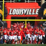 Gallery l Louisville crushes NC State 54-13