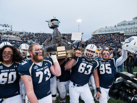 Montana State players celebrate with the Great Divide