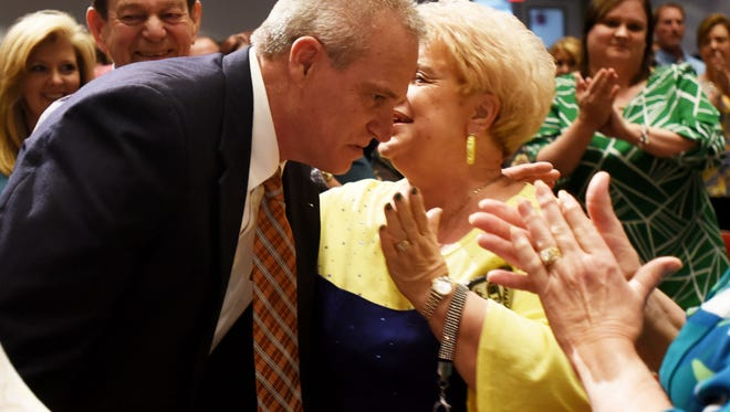 Friends and family cheer when Bossier Parish School named Scott Smith as the new superintendent on Tuesday evening.