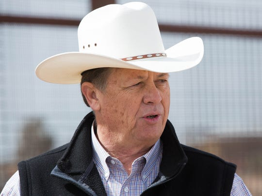Aubrey Dunn, New Mexico land commissioner and U.S. Senate candidate, holds a news conference on parcel of land on the U.S.-Mexico border near the Santa Teresa Port of Entry on Tuesday, March 6, 2018. Dunn says the one-mile tract of land is owned by state and that the Border Patrol — which uses that land to patrol the border — doesn't have the right of way.
