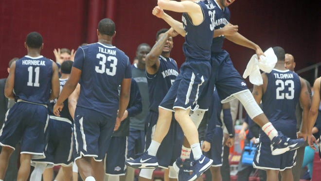 Monmouth's Collin Stewart and Chris Brady celebrate one of Stewart's second half three-pointers during a MAAC conference game against Iona at Iona College Jan. 15, 2016. Monmouth defeated Iona 110-102.