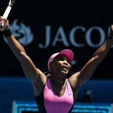 Serena Williams of the U.S. celebrates after defeating Daniela Hantuchova of Slovakia in their third round match at the Australian Open tennis championship in Melbourne, Australia, Friday, Jan. 17, 2014