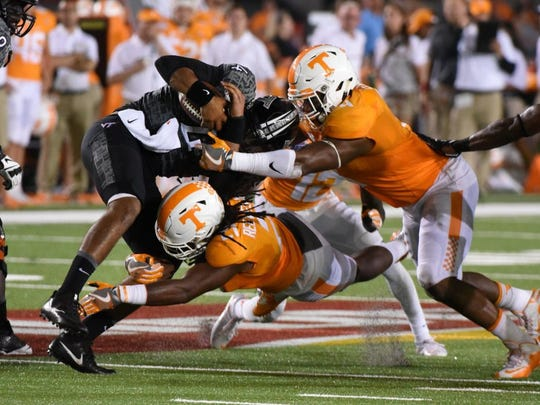 Tennessee linebacker Jalen Reeves-Maybin (21) tackles Virginia Tech quarterback Jerod Evans (4) during first half action at The Battle At Bristol Saturday, September 10, 2016 in Bristol, Tenn.