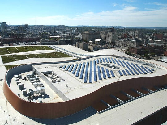 Planners of Nashville's Music City Center convention hall thought about sustainability when they installed a 211-kilowatt solar panel system in the shape of a guitar body on the center's green roof. But solar installers say climate change doesn't come up in much of the South.