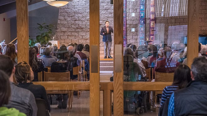 Sean Neil-Barron, assistant minister of Foothills Unitarian Universalist Church, speaks to congregants at the 9:30 a.m. service on Sunday, February 19, 2017.  Because of increased attendance, overflow from the main sanctuary now sit in an adjacent room.