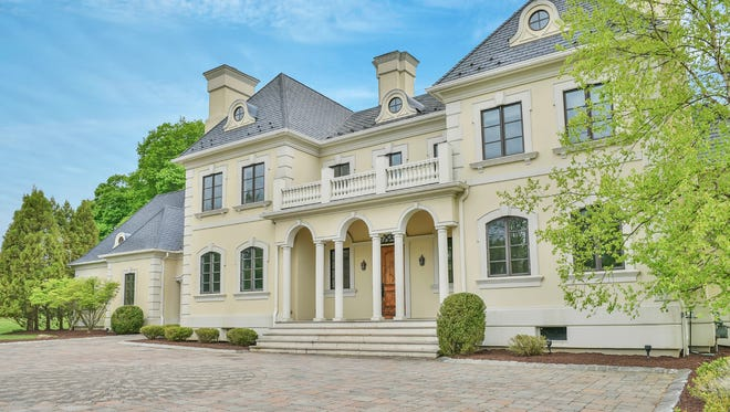 This six-bedroom home presides over five-and-a-half acres.