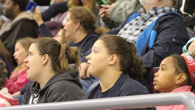 Fans look up to see game highlights on the new video scoreboard at First Arena during the Reading at Elmira preseason game on Oct. 10.