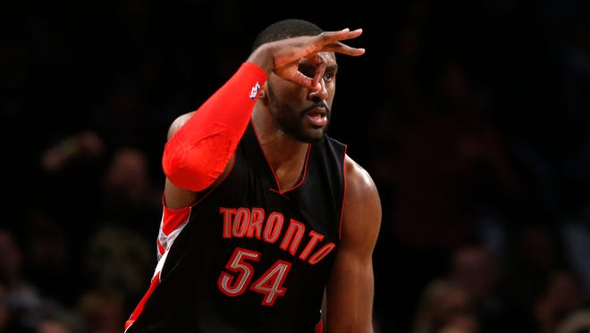 Toronto Raptors' Patrick Patterson (54) reacts after scoring against the Brooklyn Nets during the fourth quarter of an NBA basketball game Friday, Jan. 30, 2015, in New York.  Toronto defeated Brooklyn 127-122 in overtime. (AP Photo/Jason DeCrow)