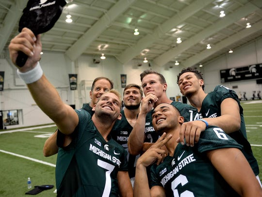 The MSU quarterback group, including senioro Tyler O'Connor (7) takes a selfie during MSU's football media day on Monday.