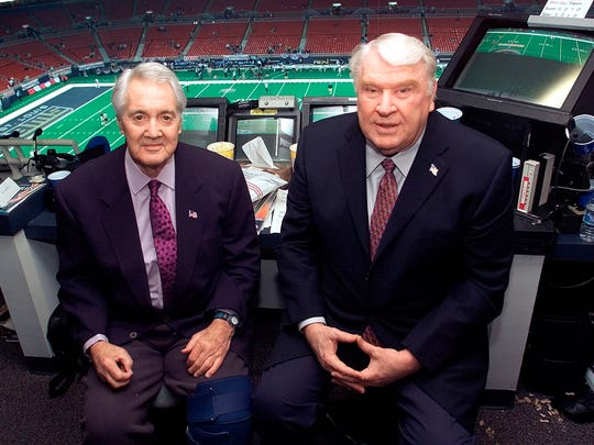 This Jan. 20, 2002, file photo shows Pat Summerall, left, and John Madden, right, in the FOX broadcast booth before the NFC divisional playoff in St. Louis.
