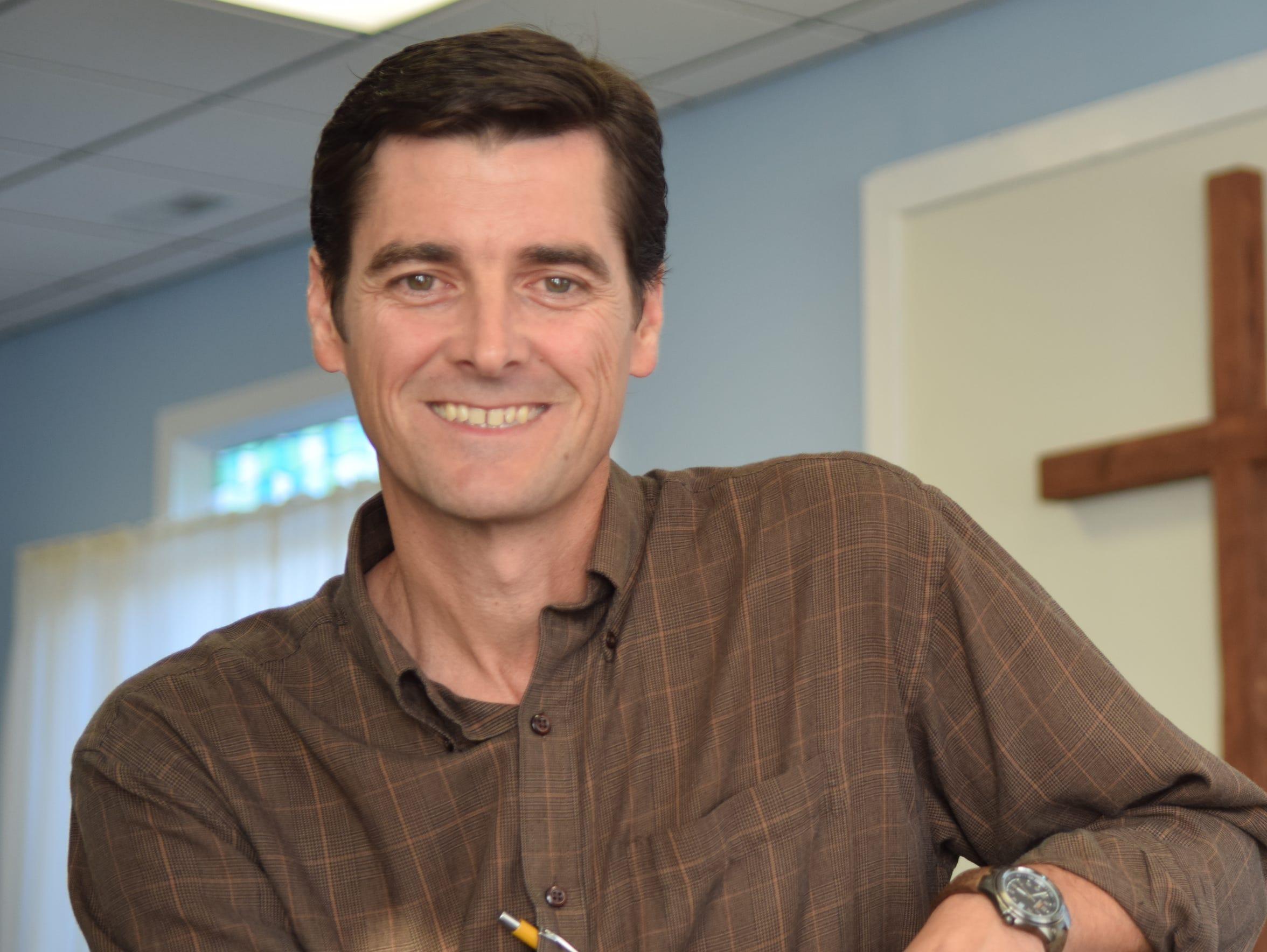 Shaun Fink is seen inside Cornerstone Bible Church,