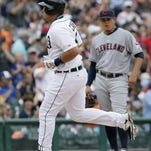 Detroit Tigers' Miguel Cabrera, left, rounds the bases past Cleveland Indians third baseman Giovanny Urshela after hitting a solo home run in a baseball game, Sunday.