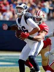 Rams quarterback Jared Goff is sacked by San Francisco defensive end Solomon Thomas during the second half on Sunday. (AP Photo/John Locher)