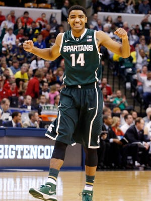 Michigan State Spartans guard Gary Harris (14) reacts to a score by the Spartans in a game against the Wisconsin Badgers in the semifinals of the Big Ten Tournament.