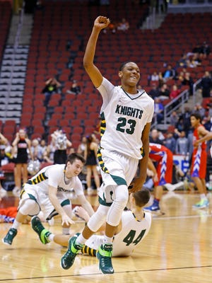 Gilbert Christian's Cameron Satterwhite (23) celebrates a win over Arcadia in their Division II championship game on Monday, March 2, 2015, in Glendale.