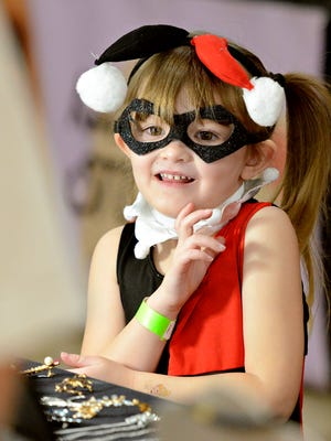 Lyra Carlos, 5, of Mount Wolf,  looks at jewelry with her partents during Comic Con at Old Main in York City on Sunday, March 6, 2016. Dawn J. Sagert photo