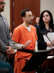 Larry Nassar is sworn in by Judge Rosemarie Aquilina  on Wednesday, Nov. 22, 2017, before pleading guilty to seven sex assault charges in Ingham County Circuit Court..