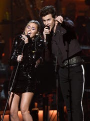 "Miley Cyrus, left, and Shawn Mendes perform ""Islands in the Stream"" at MusiCares Person of the Year honoring Dolly Parton at the Los Angeles Convention Center."
