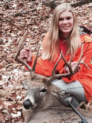 Abbey Martin bagged an 11-point buck Nov. 22 on family land near Crystal Lake