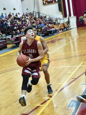 The Father Duenas Friars took on the St. John's Knights in an IIAAG Boys' Basketball League match at the Phoenix Center in Mangilao on March 4.