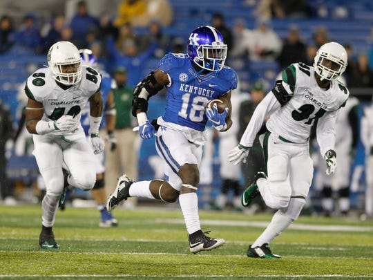 """Kentucky running back Stanley """"Boom"""" Williams (18) runs the ball against Charlotte in a 2015 non-conference game."""