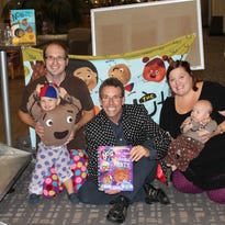 """Author Eric Litwin, center, poses with some of his fans who dressed as characters from his new book, """"The Nuts: Bedtime at the Nut House"""" for Litwin's appearance Sept. 25 at the University Center in Greenville. From left, the Forshey family of Greenville — Ellis, 2, Kevin, Sara and 2-month-old Sela — pose with Litwin. His special performance and booksigning were sponsored by Fiction Addiction."""