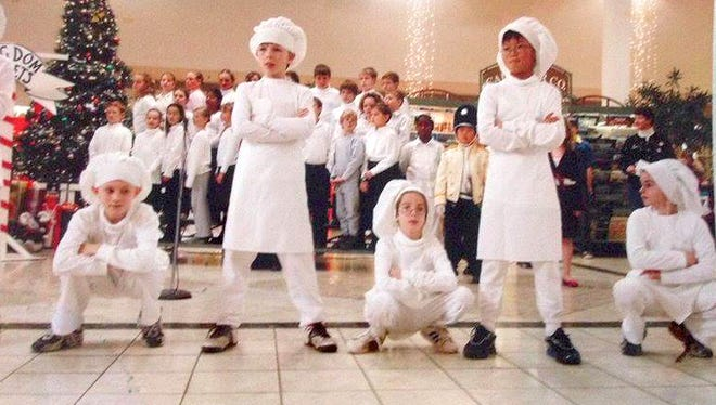 """Russian bakers from the 2007 edition of """"The Nutcracker"""" perform at the Shops at Ithaca Mall. From left are Zach Field, Shane Hradisky, John Losurdo, Emmanuel Lee,and Emory Iacobucci."""
