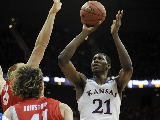 Kansas Jayhawks center Joel Embiid shoots against New Mexico Lobos forward Cameron Bairstow in the second half at Sprint Center.