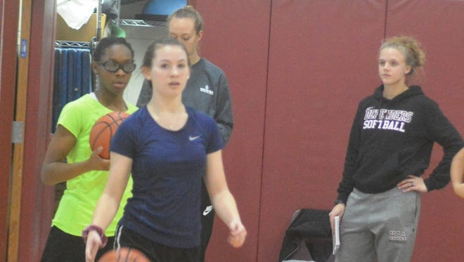Katie Goitz (right) is the new coach for the Hawthorne Christian girls basketball team.