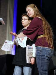 Jack Miller gets a hug from his sister, Kate, after winning the 18th annual Big Country Spelling Bee on Feb. 20, 2016.