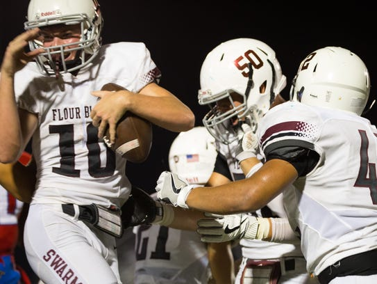 Flour Bluff's Dillon Byerley celebrates after recovering