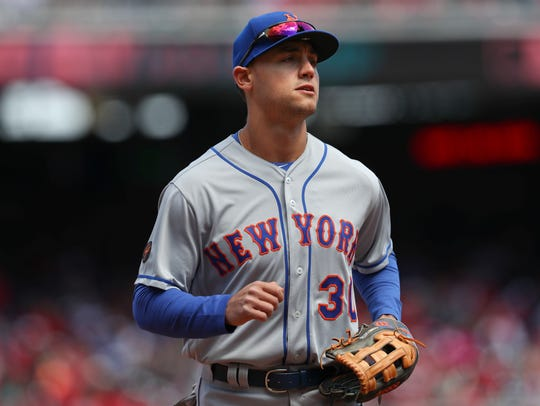 New York Mets left fielder Michael Conforto heads back