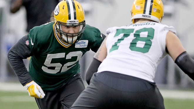 Green Bay Packers outside linebacker Clay Matthews (52) rushes against offensive tackle Jason Spriggs (78) during practice Thursday, November 2, 2017 inside the Don Hutson Center in Ashwaubenon, Wis.