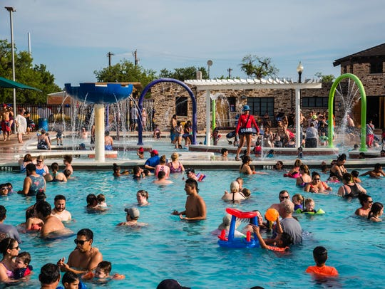 Hundreds cool off in the pool July 3, 2017, at Love