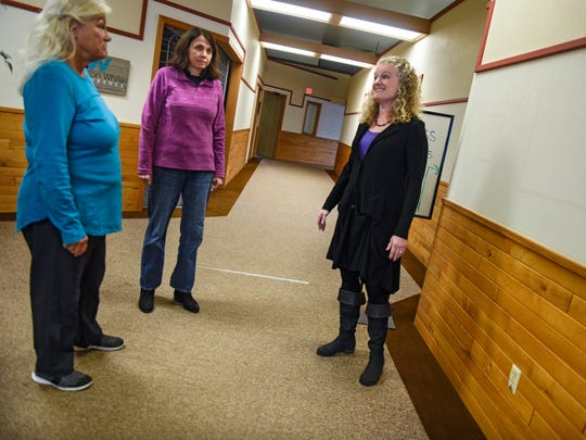 Susy Prosapio, Cathy Hartle and Darlene Brand talk about  tasks that need to be done in advance of the opening of the Purple Carrot Market Friday, March 30, in Little Falls.
