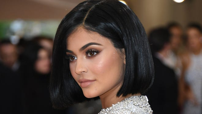 Kylie's trading her signature nude lip colors for something a little more dramatic.