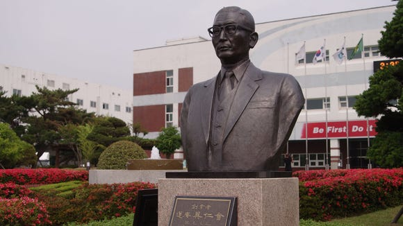 A statue of LG Group founder Koo In-Hwoi stands in front of LG's Changwon factory.