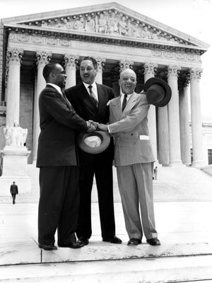 (From left:) Lawyers George E.C. Hayes, Thurgood Marshall and James M. Nabrit stand outside the U.S. Supreme Court in Washington on May 17, 1954, after winning their argument about the unconstitutionality of school segregation.