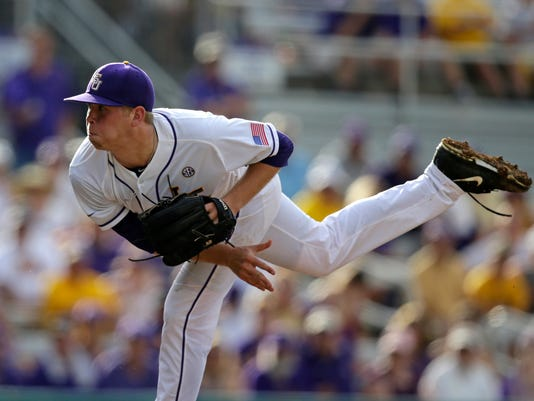LSU pitcher Austin Bain pitches in the third inning of a game against Lehigh at the Baton Rouge Regional of the NCAA college baseball tournament in Baton Rouge, La., Friday, May 29, 2015. (AP Photo/Gerald Herbert)